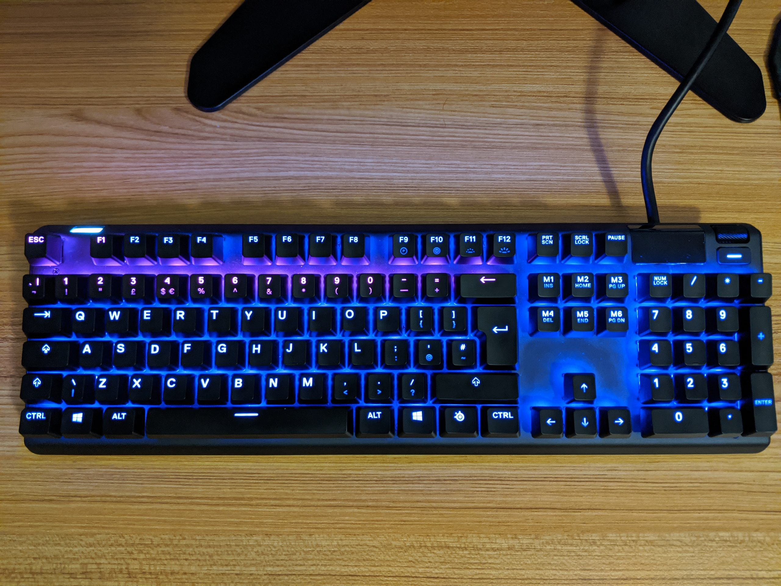 A faulty SteelSeries Apex Pro with hall effect and Cherry MX Red switches.
